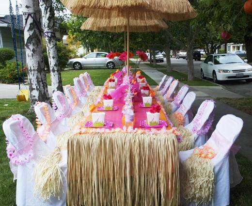 tropical party with thatch panels and thatch umbrella
