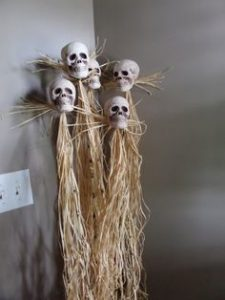 Skull on Bamboo Pole with Thatch